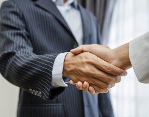 handshake op de beurs